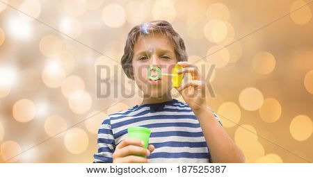Digital composite of Little boy playing with soap bubbles