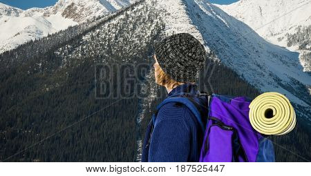 Digital composite of Hiker with backpack against mountain