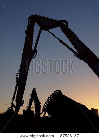 demolition - construction site in the evening with equipment excavators and mixers