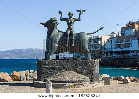 CRETE GREECE - JULY 11 2016: Europa-Statue on the quay in front of the port of the coastal town of Agios Nikolaos.