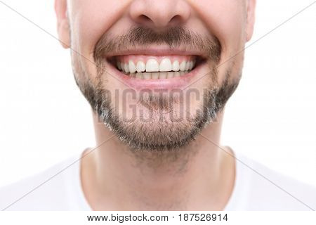 Smiling man on white background, close up