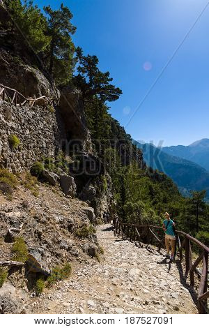 CRETE GREECE - JULY 14 2016: Samaria Gorge - a major tourist attraction of the island. Lens flare on the blue sky.