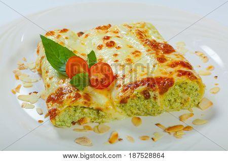 Italian Lasagna Rolls On A White Plate