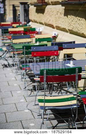 Colorful chairs and tables in front of restaurant