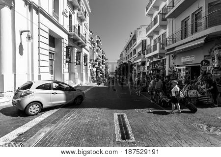 HERAKLION GREECE - JULY 16 2016: Crete. The shopping streets in the old part of the city. Heraklion - the capital and the largest city on the island. Black and white.