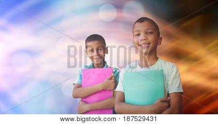 Digital composite of School children holding books against bokeh