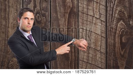 Digital composite of Confident businessman showing time on wristwatch