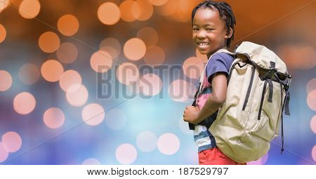 Digital composite of Rear view of school child carrying backpack over bokeh
