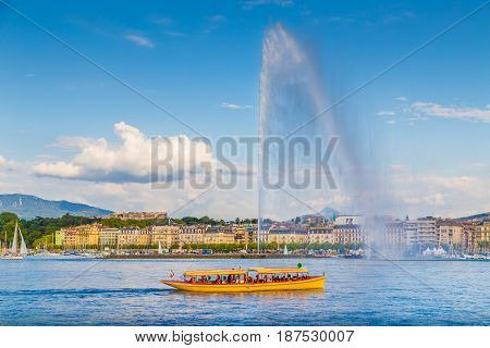 City Of Geneva With Famous Jet D'eau Fountain At Sunset, Switzerland