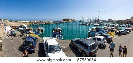 HERAKLION GREECE - JULY 16 2016: Crete. Moored fishing boats in the seaport. Panoramic view.