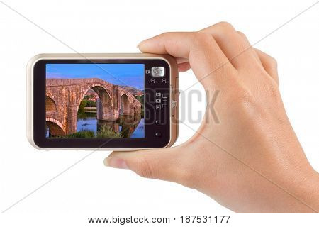 Hand with camera and Old bridge in Trebinje - Bosnia and Herzegovina image (my photo) isolated on white background