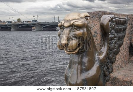 Monument to the bronze griffin in St. Petersburg on the Neva River in Russia