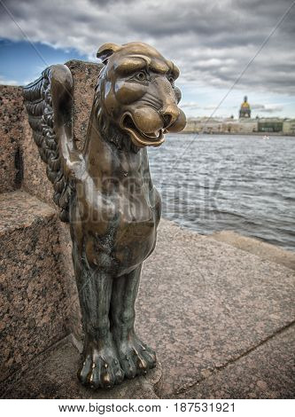 Monument to the bronze griffin in St. Petersburg on the Neva River in Russia poster