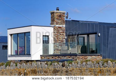 Contemporary Seafront House Mixing Modern Steel And Glass With Traditional Stone