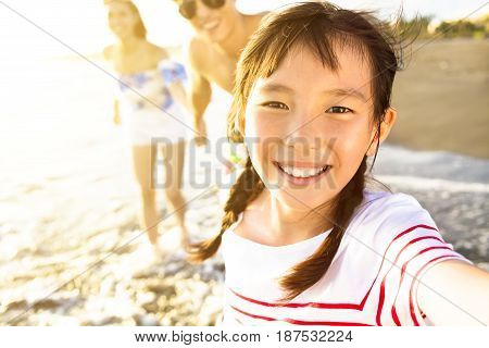 happy family walking on the beach enjoy summer vacation