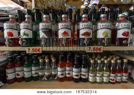 HERAKLION GREECE - JULY 16 2016: Showcase with different varieties (with the possibility of tastings) traditional alcoholic beverage - Raki.