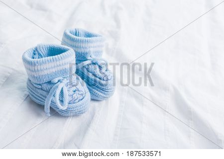 baby booties for little boy on white background