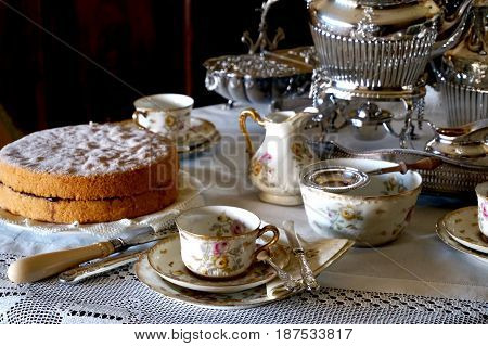 Fresh Victoria Sponge And Tea Making Essentials On A Traditional English Table
