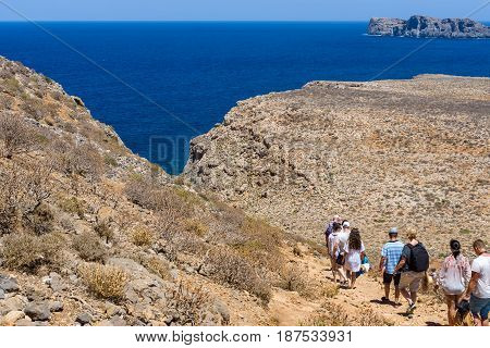 CRETE GREECE - JULY 18 2016: The descent of tourists from the ancient Venetian fortress. Natural landscape of the island Imeri Gramvousa. Mediterranean Sea.