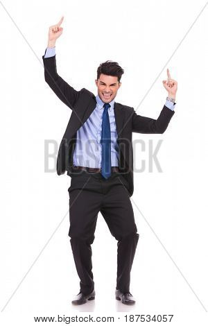young businessman celebrating success with hands up in the air on white background