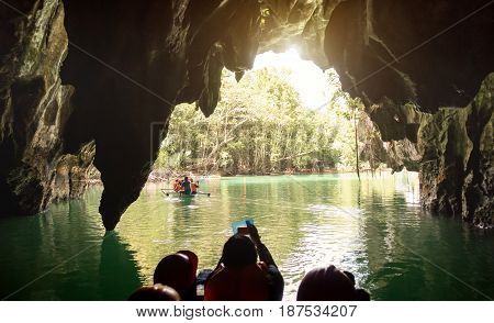Inside view point of Puerto Princesa Palawan subterranean underground river at exit side - Adventurous exclusive Philippines destinations - Dark lighting with real feelings from visitor perspective