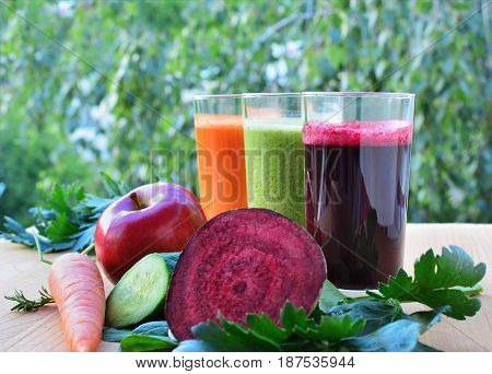 Healthy vegetable and fruit smoothies and juice in glasses.