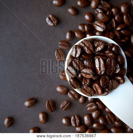 A small scoop of roasted coffee beans