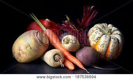 Vegetables, still life on a black background