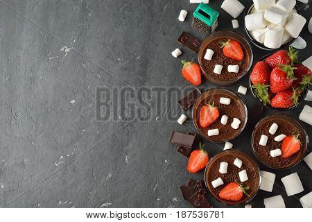 Chocolate mousse with marshmallow on a gray background