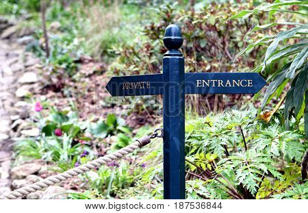 """Traditional Blue Wooden Sign Pointing To """"private"""" And """"entrance"""""""