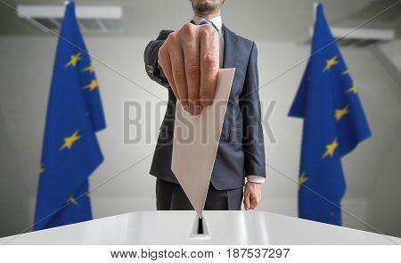 Election Or Referendum In European Union. Voter Holds Envelope I