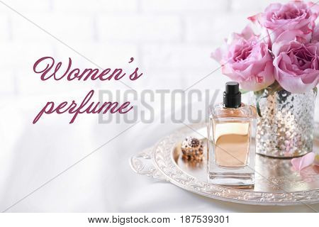 Women's perfume. Tray with bottle of scent on dressing table