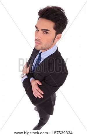 wide angle picture of a serious businessman with hands crossed on white background