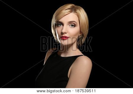 Portrait of beautiful woman on black background
