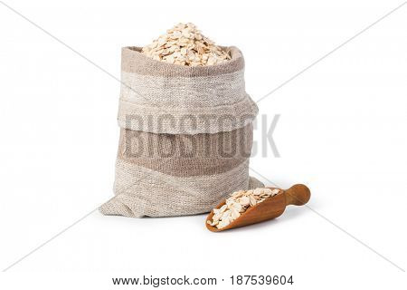 Oatmeal flakes in the bag isolated on white background