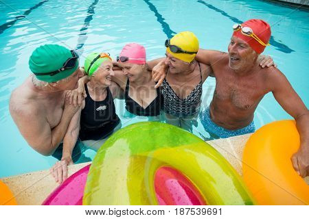 High angle view of happy senior swimmers enjoying in pool