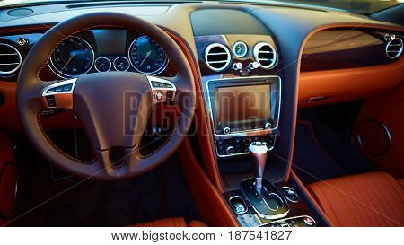 Luxury car Interior. Steering wheel and dashboard