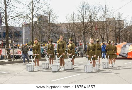 Kirishi, Russia - 9 May, A group of girls drummers in military uniform, 9 May, 2017. Preparation and conduct of the action Immortal regiment in small cities of Russia.