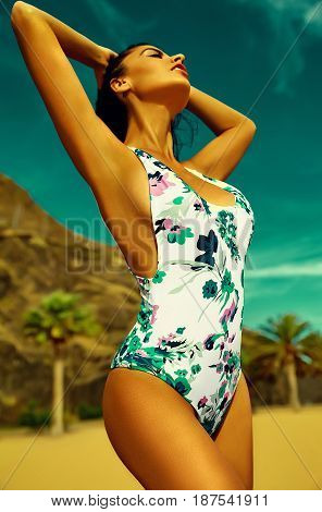 Sexy Hot Woman Model With Dark Hair In Colorful Bikini Posing On Summer Beach