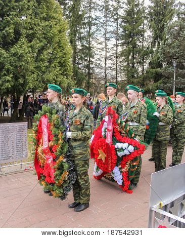 Kirishi, Russia - 9 May, Group of girls with wreaths, 9 May, 2017. Laying wreaths and flowers in memory of the fallen at the Eternal Flame.