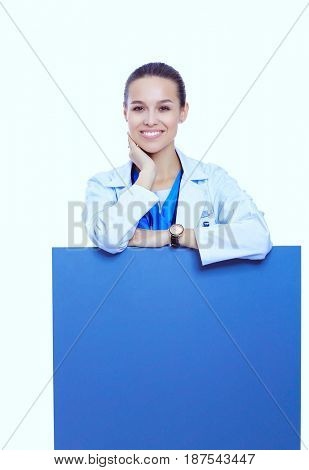 A female doctor with a blank billboard