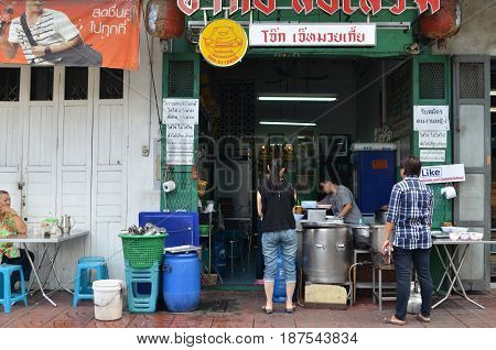 BANGKOK THAILAND- MAY 19 2017: Unidentified customers eats on a street in chinatown district Bangkok Thailand. Chinatown is renowned for its street food and outdoor dining.