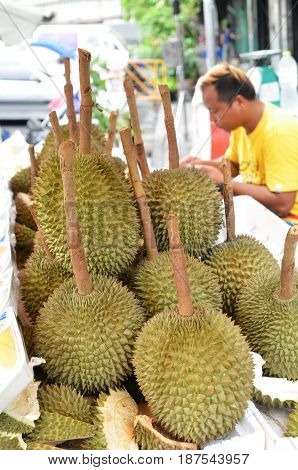BANGKOK THAILAND- MAY 19 2017: Durian vendor on the street selling of durian fruit in Bangkok Thailand