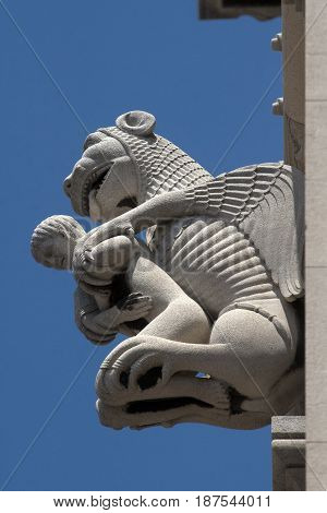 Embranchment of Adam and lion sculpture on the bell tower of cathedral in Split Croatia
