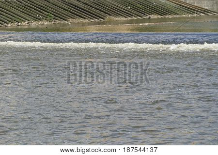 Small Weir On A Calm River
