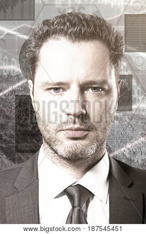 Close up portrait/headshot of handsome young businessman on digiatl business chart background. Finance concept