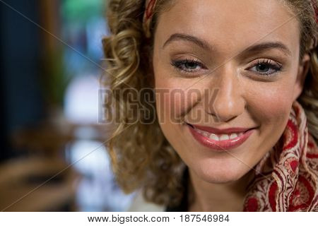 Portrait of beautiful young woman in coffee shop