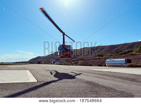 Benidorm Spain - May 13 2017: Helicopter flying away. Benidorm helicopter tour is a tourist attraction on the Costa Blanca. Province of Alicante. Spain