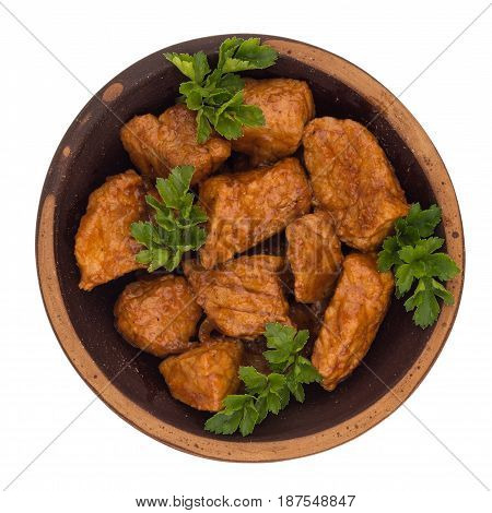 Stew in a brown plate. (Goulash) isolated on white background. Top view.
