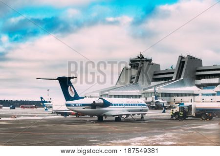 Minsk, Belarus - December 15, 2016: Aircraft Airlines Belavia fueling at the Minsk National Airport - Minsk-2 terminal at winter day